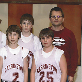 Daniel Wold with youth basketball players